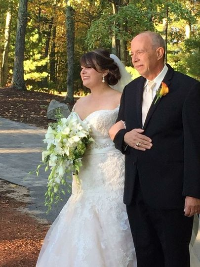 Daddy's little girl chose and elegant cascade style bouquet .