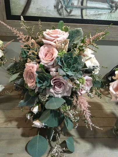 Gray Green succulents and  roses . a loosely styled cascade.