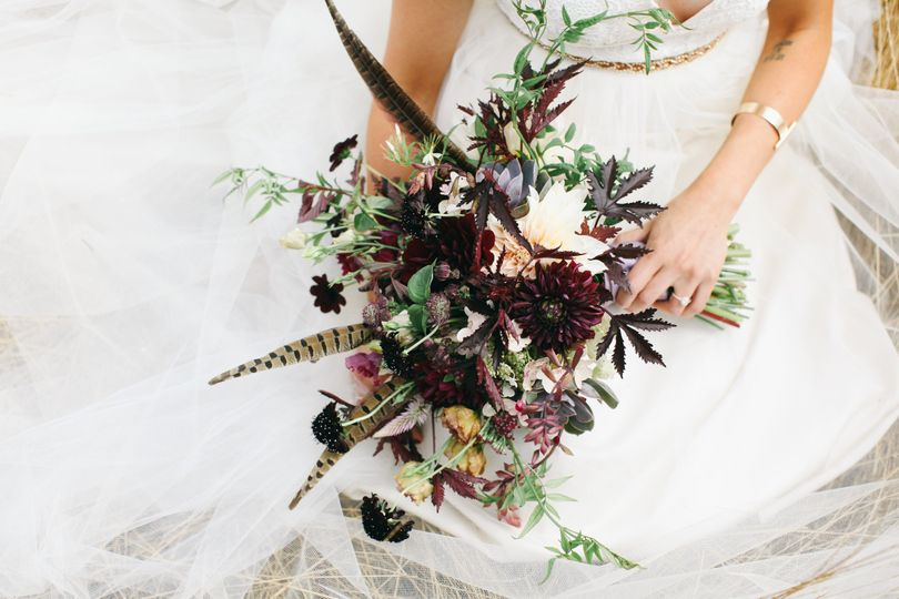 Bo-ho bride with Blush and Marsala bouquet.