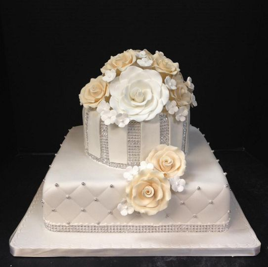 Two layered wedding cake with flowers