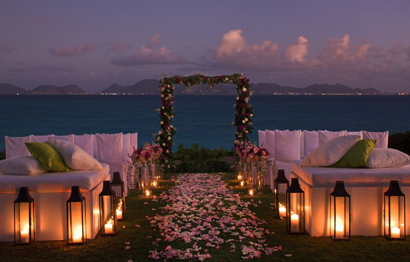 Wedding ceremony on the lawn, ocean-side at Cap Juluca.