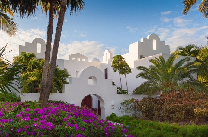 Beautiful architecture of Cap Juluca with lush gardens.
