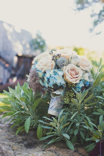 Photo Courtesy of One Little Spring Photography. (http://www.onelittlespring.com). Flowers by Love...