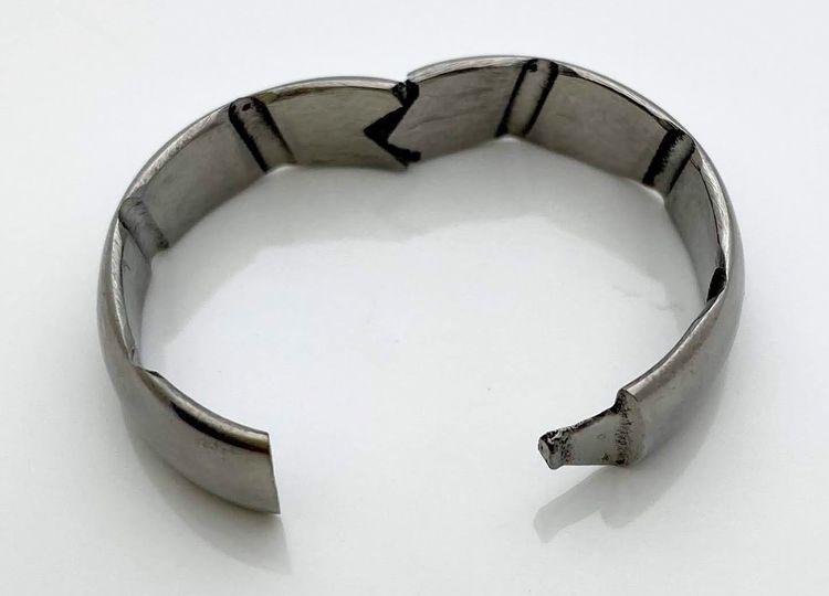 Open hinged titanium ring