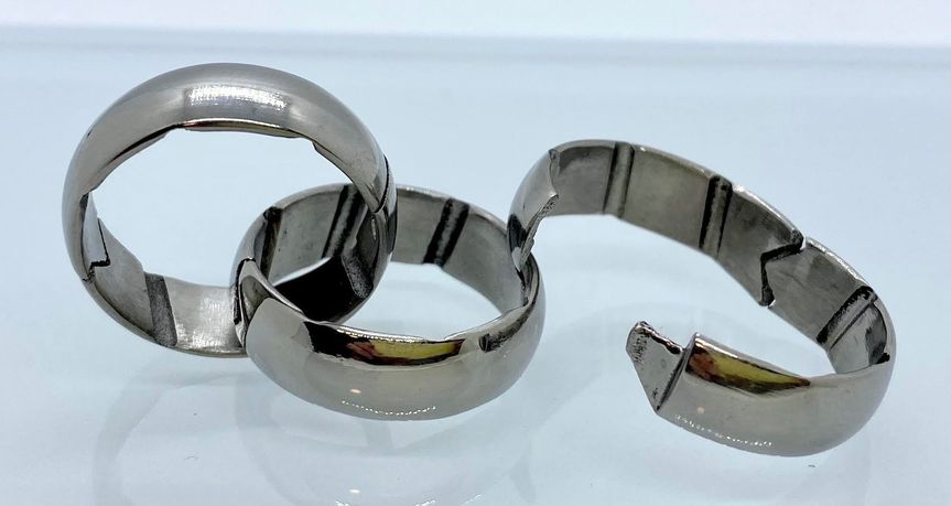 Hinged titanium ring