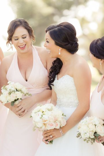 Laughing with the bridesmaids