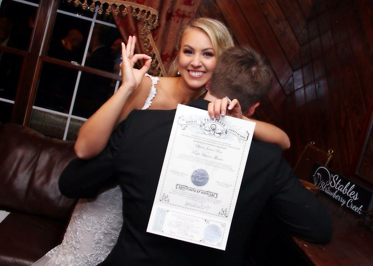 Bride showing off her marriage certificate