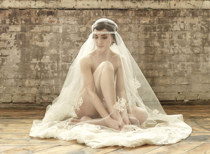 Silk tulle veil with lace appliques and train. Photo courtesy of Julia Boggio