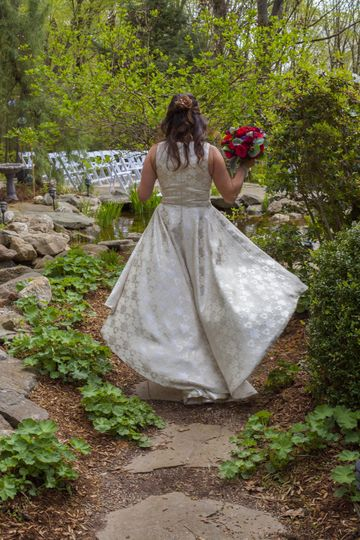 Bride walking through a forest
