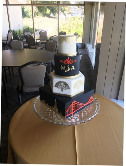 This cake was decorated with inspiration from the wedding invitation. The gold detail is hand...