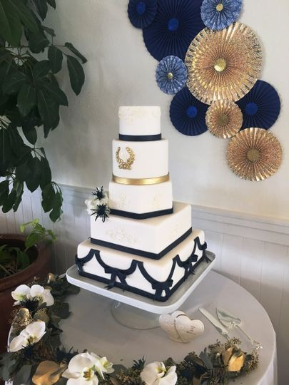 wrapped five tiers with monogram blue bands bows a