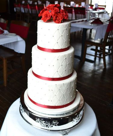 3-tier wedding cake with red ribbons