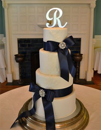 Wedding cake with navy ribbons
