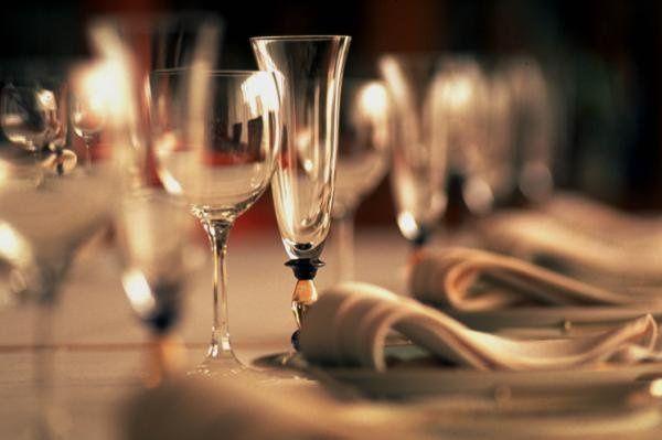 Elegant place setting during wedding reception.