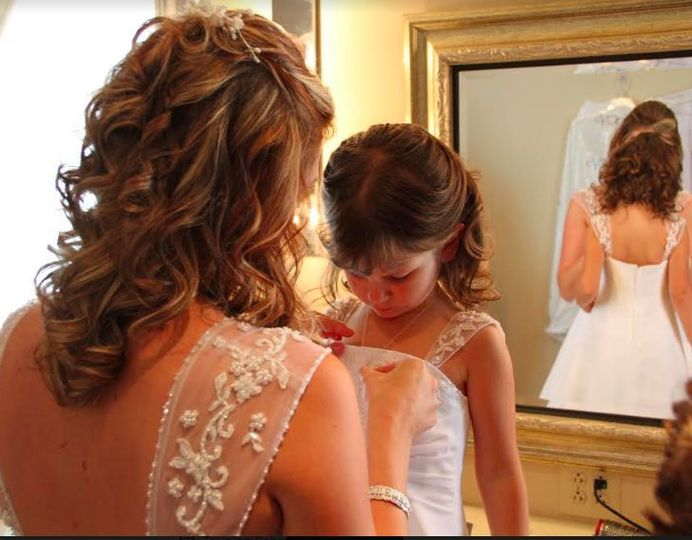 Bride helping the flower girl