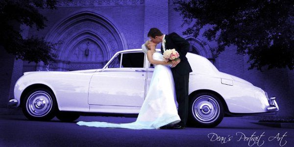 1958 White Roll Royce Silver Cloud 1 with Blue Background w couple.