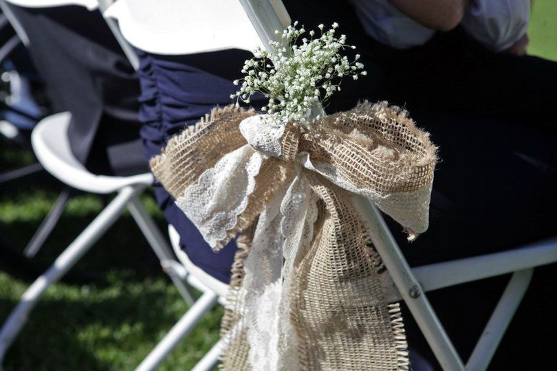 Burlap and lace chair bow accented with babies breath