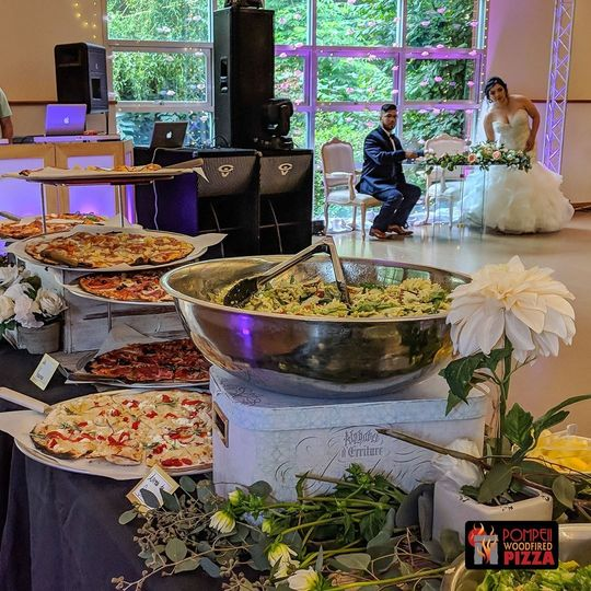 Bountiful pizza and salad spread