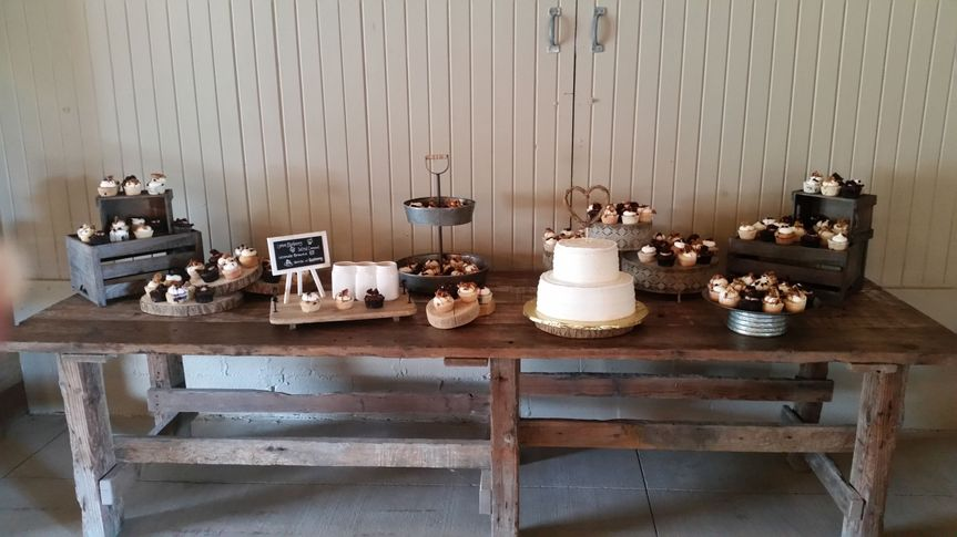 Cupcake spread and tiered wedding cake at jorgensen farms
