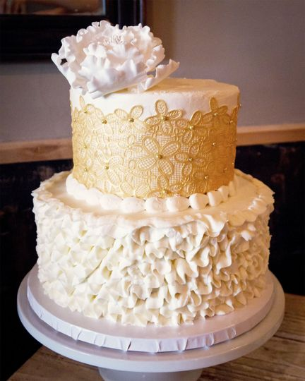 Gold lace and buttercream ruffle cake with peony topper at the wine bistro in westerville