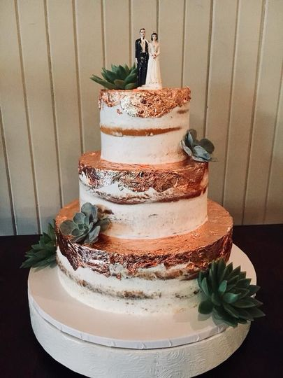 Rustic tiered wedding cake with edible copper accents