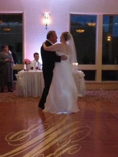 Father-Bride Dance at a wedding at Scenic Hills Country Club in Pensacola. You can see the custom...