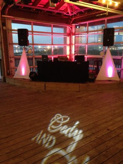 Our setup at Margaretville - Pensacola Beach. We had some pink up lighting with the custom monogram...
