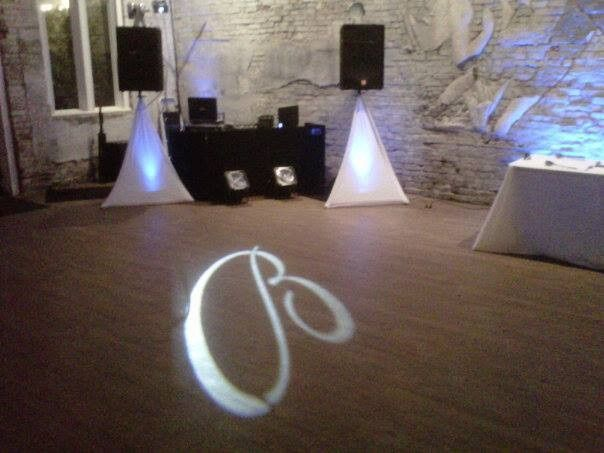 Custom Monogram with up lighting at 5Eleven Palafox in downtown Pensacola.