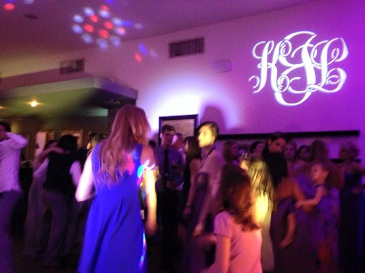 Guests dancing at a wedding reception at 5Eleven Palafox in Pensacola. You can see  the custom...