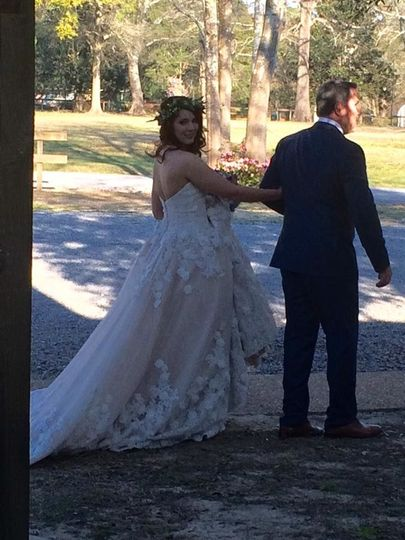 Bride and her father getting ready to walk down the aisle at Live Oaks Plantation in Gulfport,...