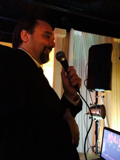 Our Entertainment Director (and your DJ) Stacey Noles talking to the crowd at a wedding reception.