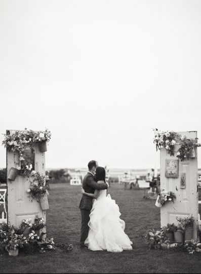 Newlyweds hugging each other | PC: Jen Huang Photography