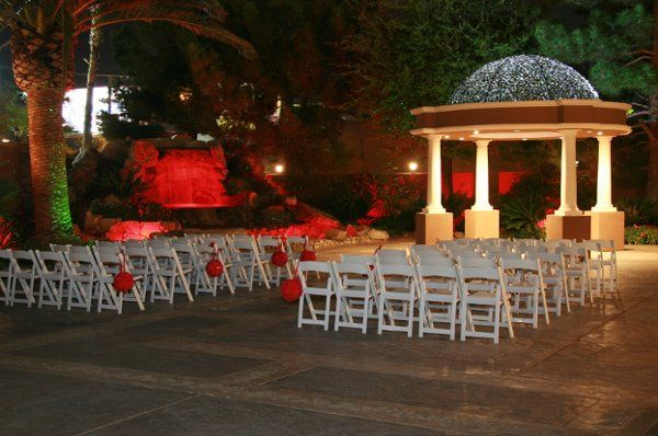Outdoor Chapel at night with red flower balls and red accent lighting