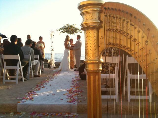 Harp music and and a late afternoon golden glow at a Faria Beach wedding.