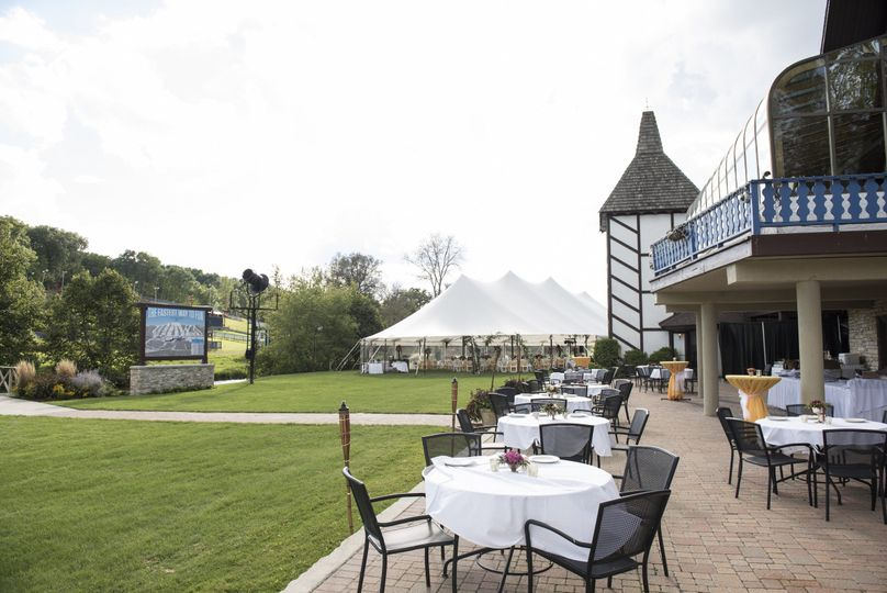 Outside wedding summer 2016 Happy Hour on the patio with a full bar before going to the tent for the...
