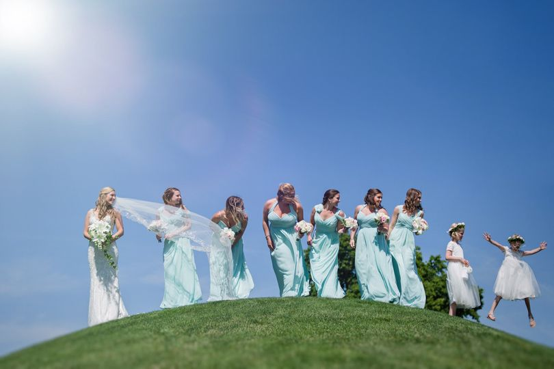 Bride, bridesmaids, and flower girls