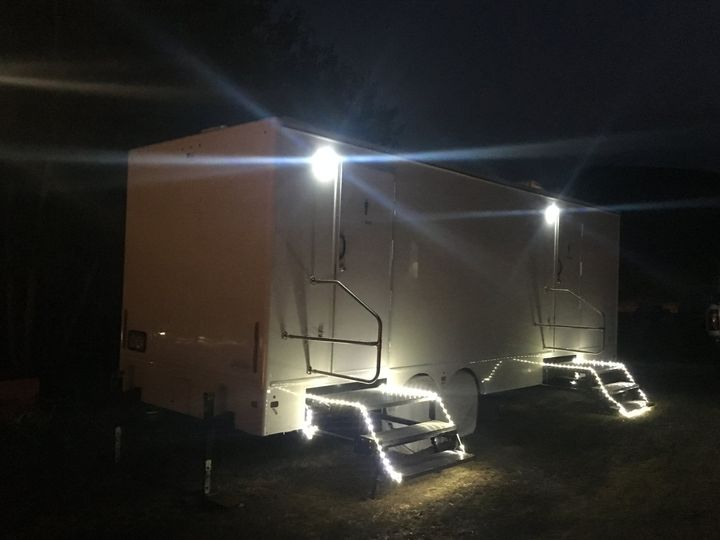 Portable luxury restroom at night