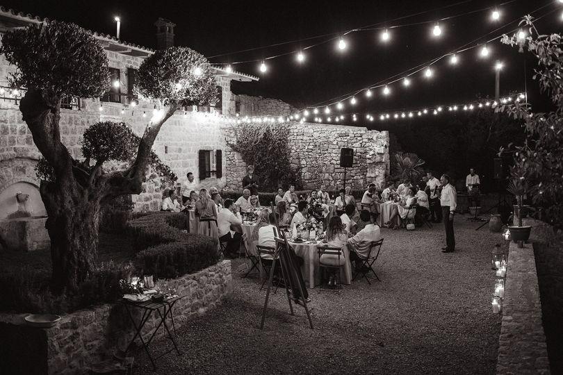 Garden reception with string lights