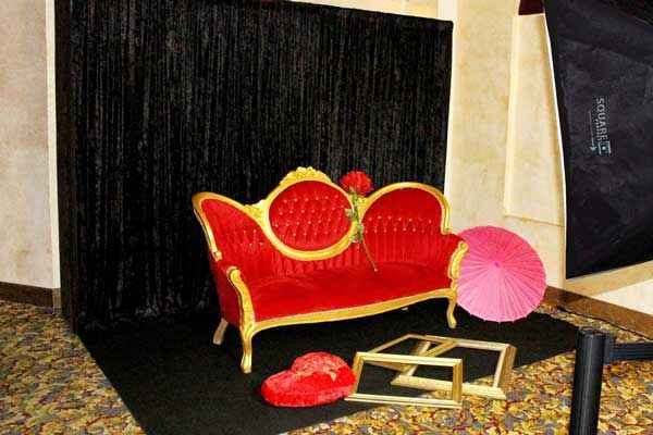 Our newest vintage red settee prop for our red carpet backdrop wedding shoots.