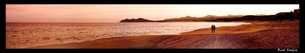 A romantic sunset walking at the beach. This couple have just finished their engagement photo...
