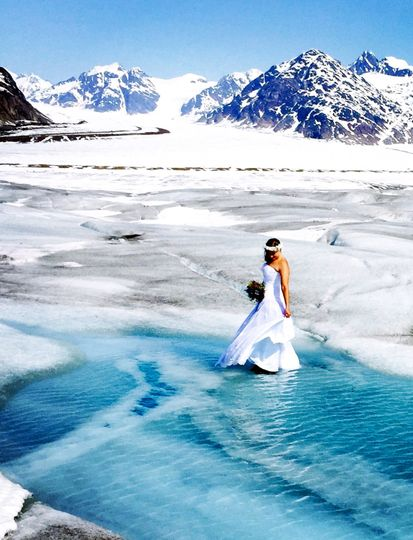 The bride dances on Azure Blue Glacier Water.