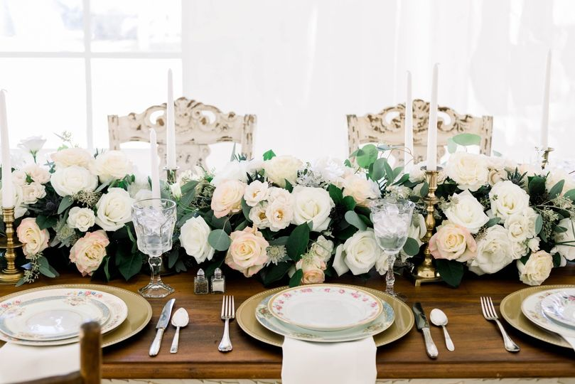 Head table with lots of flowers