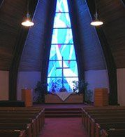 The front of our lovely sanctuary focuses on the stained glass windows with its flowing ribbons of...