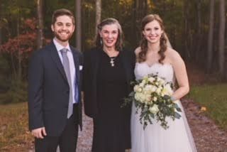 Officiant photo with the newlyweds