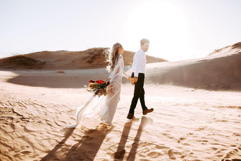 bride groom walking on sand little sahara state park oklahoma 51 1060965 1555988146