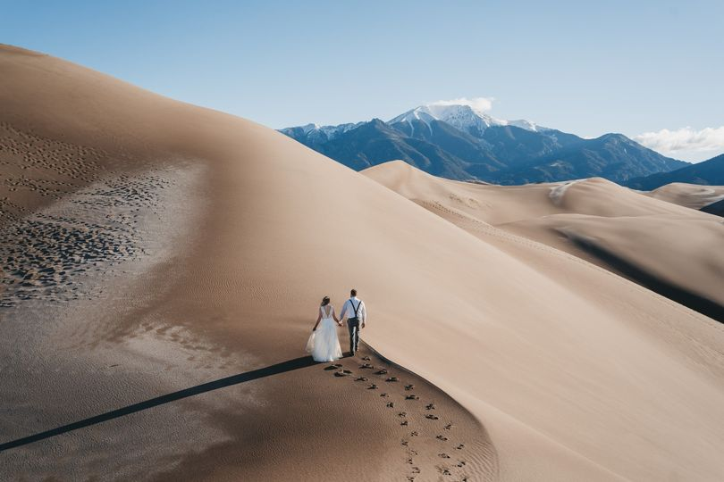 Couple hiking dunes