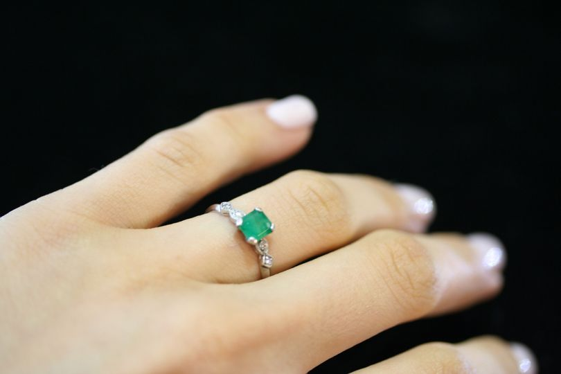 emerald engagement ring custom designed and handmade by Secrète Fine Jewelry in Bethesda, MD and...