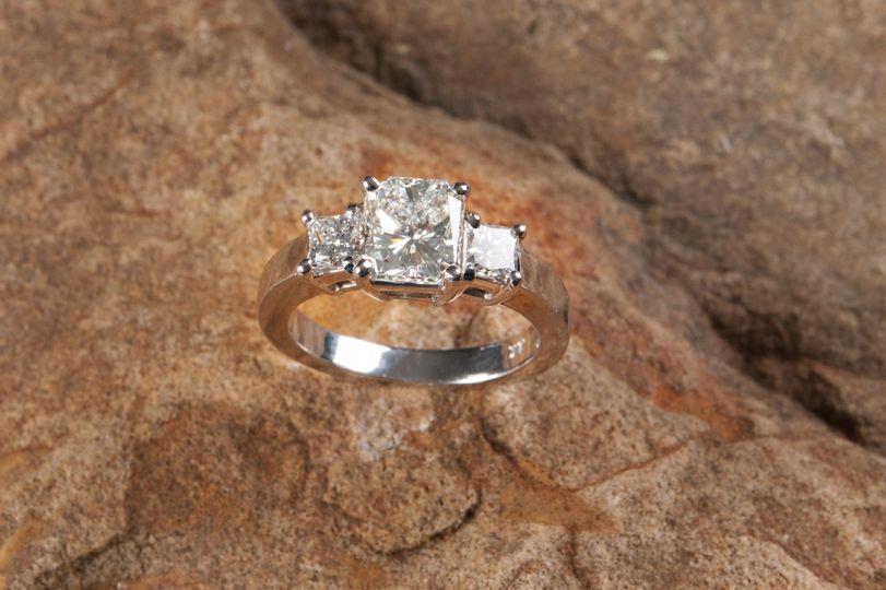 internally flawless three stone engagement ring in platinum custom designed and handmade by Secrète...