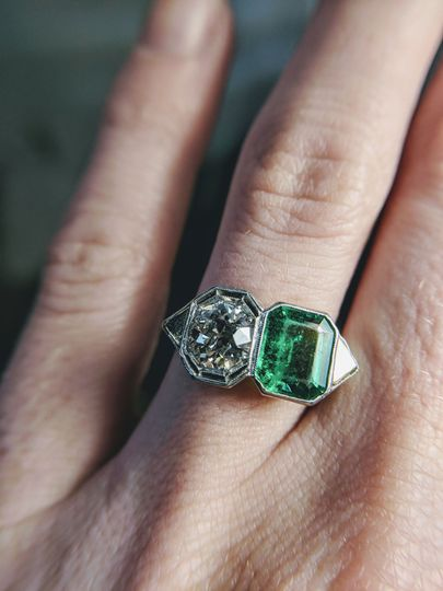 unique old european cut diamond and emerald two stone Edwardian engagement ring available at...