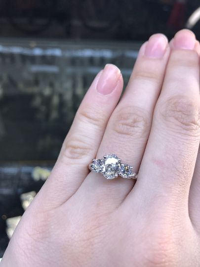 three stone oval and round engagement ring on twisted rope mounting custom designed and handmade by...